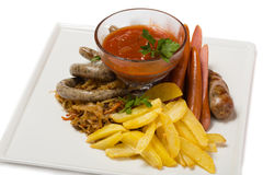 Set of tasty different sausages with roasted potatoes Royalty Free Stock Photography