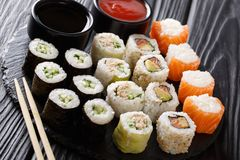 Set of tasty Japanese rolls closeup with sauces on a stone. hori Royalty Free Stock Image