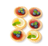 Set  of tasty tartlets with lemon and raspberry jam isolated. Set  of tasty  tartlets with lemon and raspberry jam isolated Stock Photography