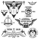 Set of tattoo emblems, elements and tattoo machines. Royalty Free Stock Photography