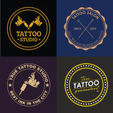 Set tattoo logos of different styles. Set of logos with a tattoo machines, ink and needles for a tattoo of salon, studio or the artist. Vector illustration Royalty Free Stock Photo