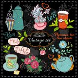 Set of tea collection. With a tea cup and flowers in vintage style stylized drawing with chalk on blackboard Stock Photography