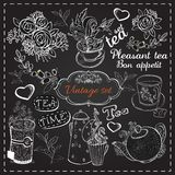 Set of tea collection. With a tea cup and flowers in vintage style stylized drawing with chalk on blackboard Royalty Free Stock Photo
