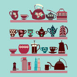 Set of tea collection with a tea pot, tea cup, jars, jugs on the Royalty Free Stock Photo