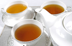 Set of tea cups. Set of porceliane tea cups and teapot Royalty Free Stock Image