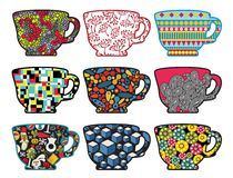 Set of tea cups with cool patterns. Royalty Free Stock Photo
