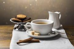 Set of tea cups with saucer and milk jug. A set of tea cups with saucer and milk jug on light grey napkin Stock Images