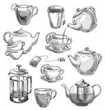 Set of tea cups and teapots. Vector sketch. Royalty Free Stock Photography