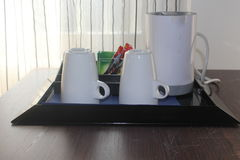Set for tea preparation in a hotel. On the table in a suite Royalty Free Stock Image