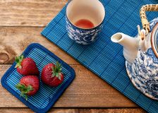 Tea with strawberries royalty free stock images