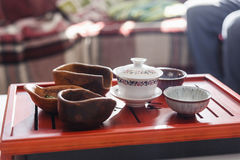 Set of teapot, three kinds of tea and four bowls Stock Photo