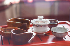 Set of teapot, three kinds of tea and four bowls Stock Images