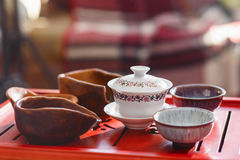 Set of teapot, three kinds of tea and two bowls Royalty Free Stock Photography
