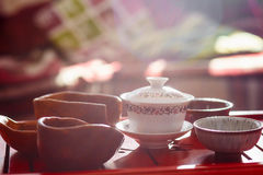 Set of teapot, three kinds of tea and two bowls Stock Photo