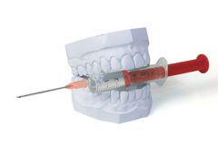 Set of teeth bites on syringe Stock Photos