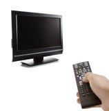 Set televisivo e un telecomando Fotografia Stock Libera da Diritti