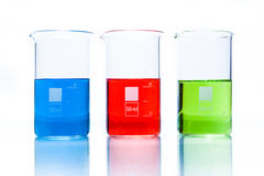 Set of temperature resistant cylindrical beakers with color liquid Royalty Free Stock Images