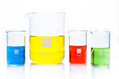 Set of temperature resistant cylindrical beakers with color liquid Stock Photography