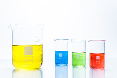 Set of temperature resistant cylindrical beakers with color liquid Royalty Free Stock Photos