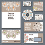 Set of templates for business. Set of templates for cd disks, envelopes, notebooks, credit card, business card and invitation card with floral ornament Royalty Free Stock Photography