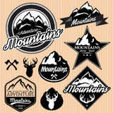 Set of templates for emblems with different mountains Stock Images