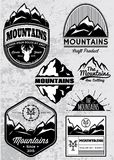 Set of templates for emblems with mountains Royalty Free Stock Photo
