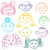 Set of ten colorful cute kids. Funny children drawings of faces. Sketch style. Royalty Free Stock Photos