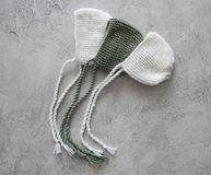 Set of tender knitted hats for newborn Royalty Free Stock Image
