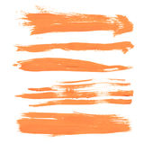 Set texture orange paint smears on white Royalty Free Stock Photography