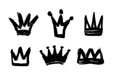 Set texture strokes thick paint in the form of a crown isolated on white background. Set of black hand drawn crowns. Vector Illustrations Stock Photo