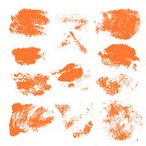 Set of textured dry brush strokes of orange paint Stock Image