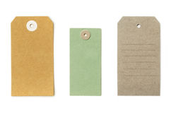 Set of textured grungy recycled paper tags of various shapes Stock Photos