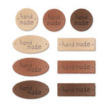 Set of textured leather tags for hand made products Royalty Free Stock Photo