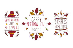 Set of Thanksgiving elements and text on white background. Set of Thanksgiving elements. Hand-sketched typographic elements on white background. Give thanks and Royalty Free Stock Photography