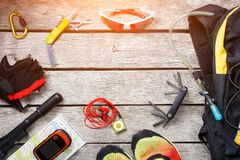 Set of things and tourist equipment for travel and adventure on a gray wooden background. Top view set royalty free stock photo