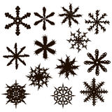 Set of thirteen snowflakes. Black silhouette. Stock Photography
