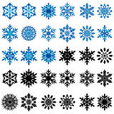 Set of thirty blue and black snowflakes Stock Photography