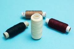 Set of threads on a blue background stock illustration