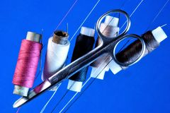 A set of threads and scissors, all ready for creativity. royalty free stock images