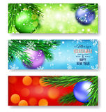 Set of three banners with Christmas. Set of three horizontal banners with Christmas and New Year. Fir tree branches on blurred background with balls. Place for Stock Photo