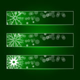 Set of three banners with snowflakes. Set of three banners with snowflakes on a green background with backlight. Vector Stock Photo