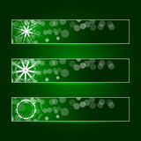 Set of three banners with snowflakes. Vector. Set of three banners with snowflakes on a green background with backlight Royalty Free Stock Photos