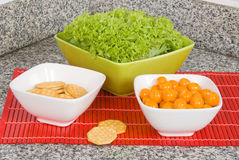 Set for three Bowls with fruit and cookies Royalty Free Stock Images