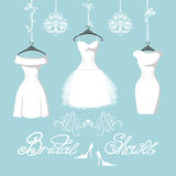 Set of  three bridal dresses hang on ribbons Stock Photography