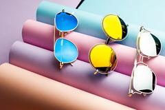 Sunglasses  :  different bright colored funky glasses for UV protection from the sun. Eye glass