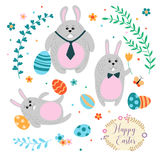 Set of three cute Easter bunnies and painted eggs in a cartoon style. Royalty Free Stock Photography