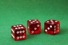 Set of three dice on green Stock Images
