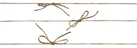 Set of three different string or braided twine tied. In a bow on white background stock photography