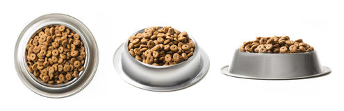 Set of three dishes dry pet food in a metal bowl isolated on white background. Top, half and front view. Stock Image