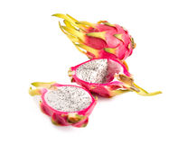 Set of three dragon fruits, whole and cut in half Stock Photo